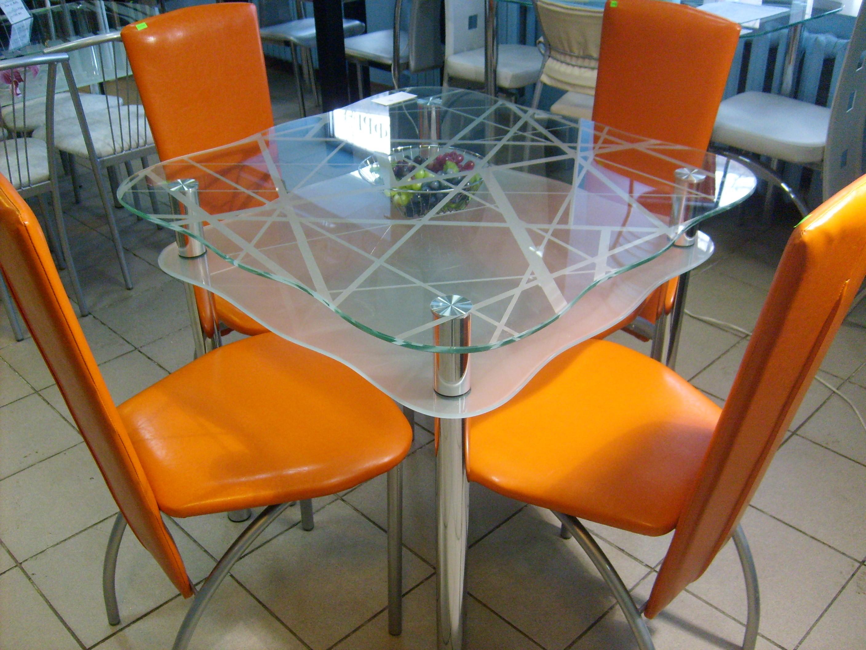 Фото обеденного двухуровневого стола из стекла